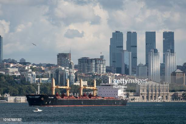 On 10 August 2018 a cargo ship navigates the Bosphorus Strait in front of the historic Dolmabahce Palace and the newly built highrise skyscrapers of...