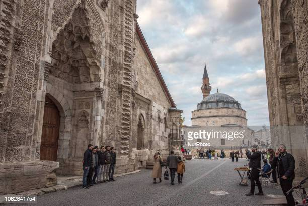 On 10 November 2018 tourists take photos between the historic Cifte Minare Medrese and the Sifaiye Medresesi in central Sivas a city in Turkey's...