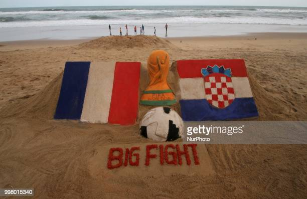 On 13 July 2018 the Indian sand artist Manas Sahoo creates FIFA WOrld Cup 2018 final sand sculpture for visitors attraction at the Bay of Bengal...