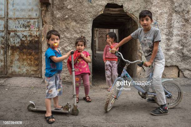 On 16 Oct 2018 children on bicycles and scooters pose in a narrow street in a lowincome neighborhood in Gaziantep a city in southern Turkey