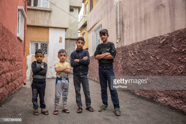 On 16 Oct 2018 four young boys pose in a narrow street in a lowincome neighborhood in Gaziantep a city in southern Turkey