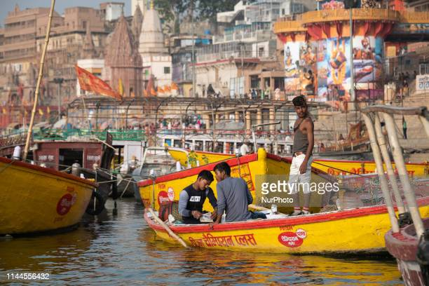 On 18 May 2018 young Indian men sit on a row boat on the Ganges River which is considered to be holy and pure in the Hindu religion Photo taken in...