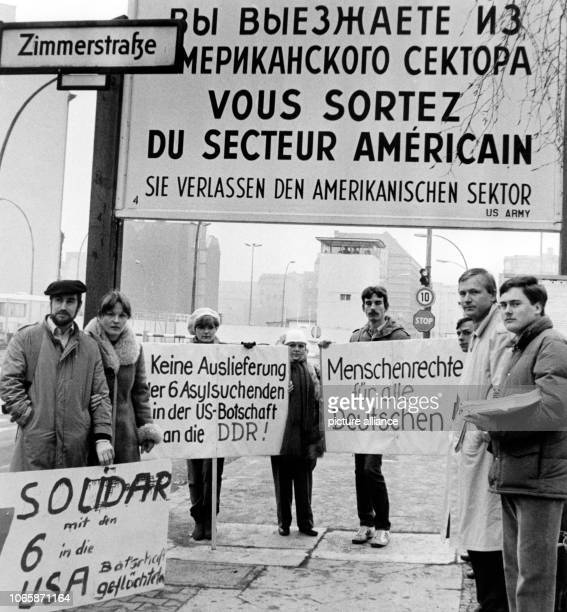 On 21st January 1984 members of the 'Junge Union' are demonstrating in front of Checkpoint Charlie in West Berlin for six GDR sitizens who have...