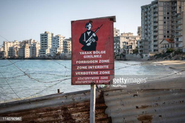 """On 24 April 2019, a military sign reading """"Forbidden Zone"""" is visible on a barrier on Palm Beach in Famagusta, also known as Gazimagusa, in..."""