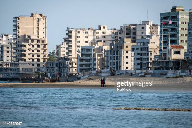 On 24 April 2019, tourists visit on Palm Beach in Famagusta, also known as Gazimagusa, in Northern Cyprus, near a military separation line that...
