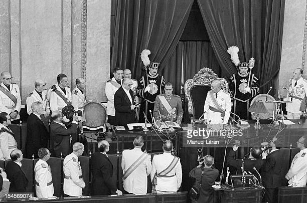 On 24 July 1969 the gallery of the palace of the Cortes in Madrid Spain the Prince of Spain and Franco's successor Juan Carlos standing and Franco...