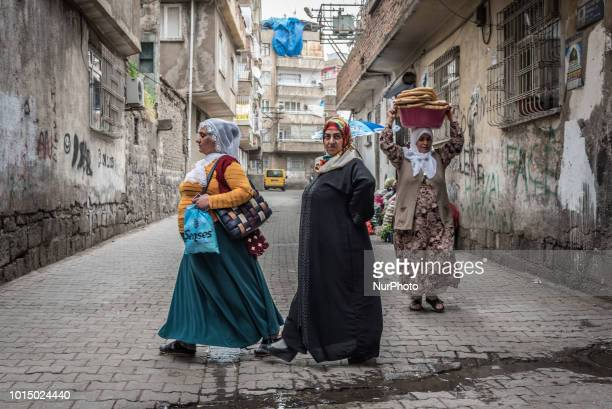 On 24 March 2018 Kurdish women walk in the streets of the historic Sur district in Diyarbakir Turkey an area that was heavily damaged during military...