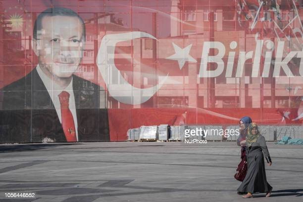 On 27 Oct 2018 two covered women walk by a large street advertisement showing Turkish President Recep Tayyip Erdogan in Konya a conservative...