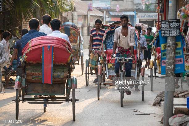 On 30 May 2019 Bengali people walk and ride rickshaws in crowded streets markets and urban shopping areas in Dhaka the capital city of Bangladesh...