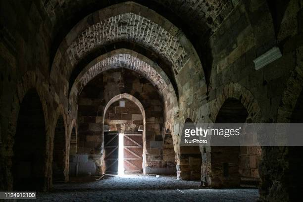On 9 February light enters through an open door of a dark chamber with stone archways in the historic Cacabey Kervansarayi building in the village of...