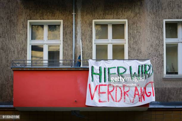 On a balcony a residential building in Berlin Neukoelln hanging banner with the inscription ' here is displaced ' on February 07 2018 in Berlin...