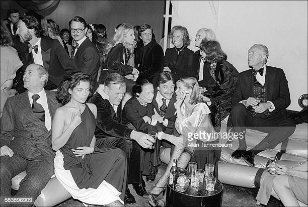 On a banquette at Studio 54 Bianca Jagger Diana Vreeland Andy Warhol and others talk and drink New York New York March 6 1978