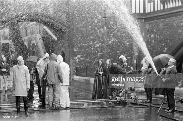 On a beautiful summers morning at the Tower of London BBC film unit produced rain and lots of it for the filming of 'Elizabeth R' featuring the life...