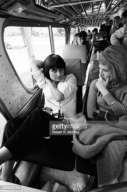 On a bus on their way home from a visit to Stan Vanderbeek's studio and 'Movie Drome' theatre as part of the New York Film Festival French film...