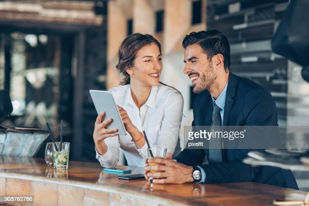 on a business trip together - wealth stock pictures, royalty-free photos & images