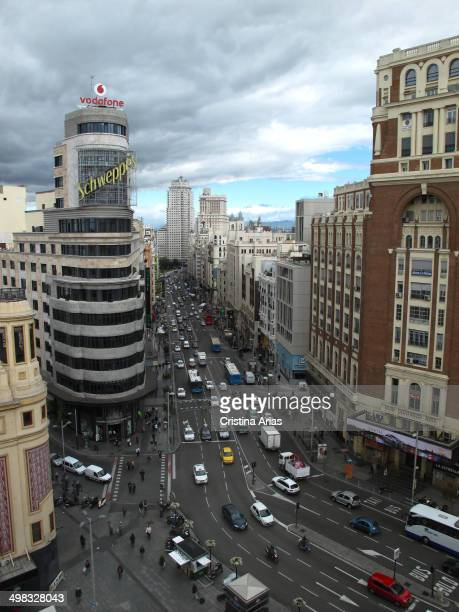 On a cloudy day of the third section of the Gran Via de Madrid from the Plaza de Callao first Carrión and the Palace of Prensa buildings and...