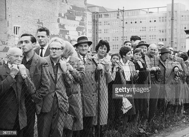On a day when the Berlin Wall is open throngs of West Germans wait for friends and relatives to arrive from the Eastern sector
