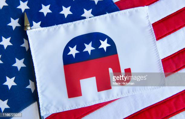 republican elephant symbol on a flag on top of the american flag. - republican party stock pictures, royalty-free photos & images