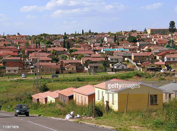On a hillside in Soweto South Africa neat rows of red roofs characterize a new middleclass neighborhood in the former black township Since a 1976...