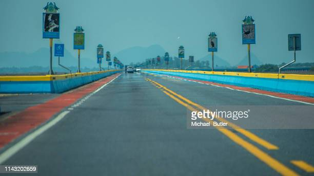 On a hot highway in Trang Province