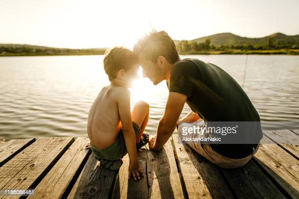 on a lake with my dad - jetty stock pictures, royalty-free photos & images