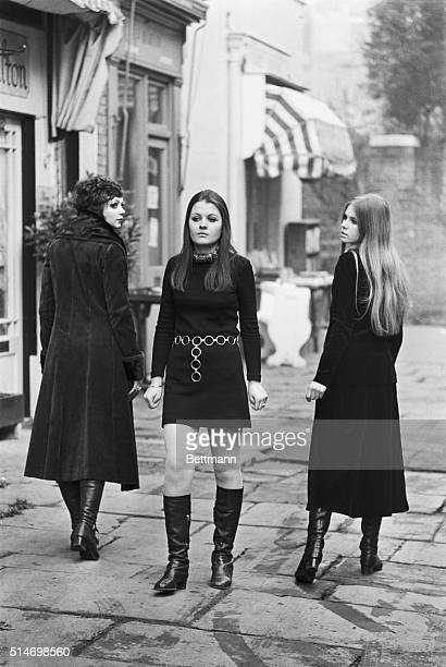 On a London street one young woman defies fashion by continuing to wear the miniskirt while two other young women wear the newer maxiskirt in 1967