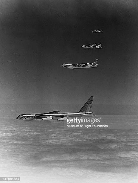 On a photo flight above the cloud cover Boeing B52 B47 B29 and B17 Bombers fly in echelon formation
