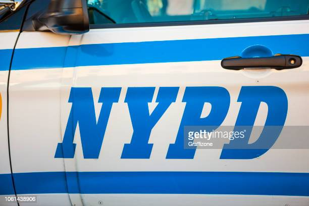 nypd on a police car - new york city police department stock pictures, royalty-free photos & images