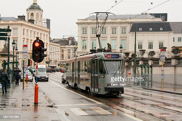 On a rainy day articulated tramcar 7771 works it way at line 92 to Schaarbeek over one of the main streets of Brussels. The stops on this street are...
