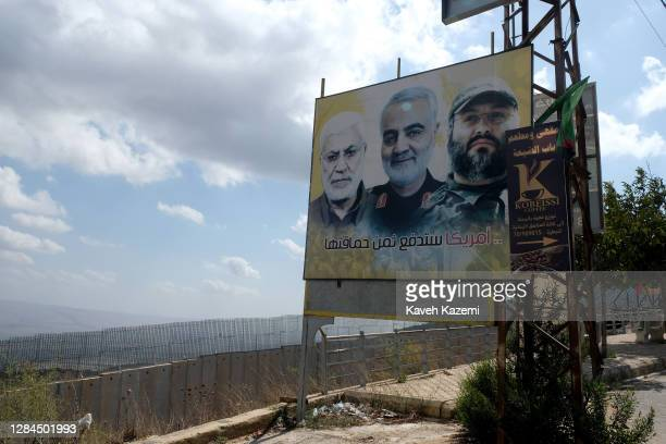 On a roadside billboard near the 11km concrete wall built by Israelis in 2018 designed to protect Israeli communities from Hezbollah infiltrations...