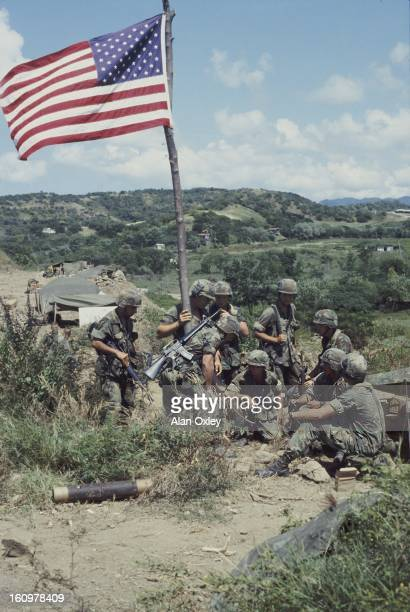 On a rocky ridge near Point Salines US Marines set up an outpost during the US invasion of Grenada in Oct 1983