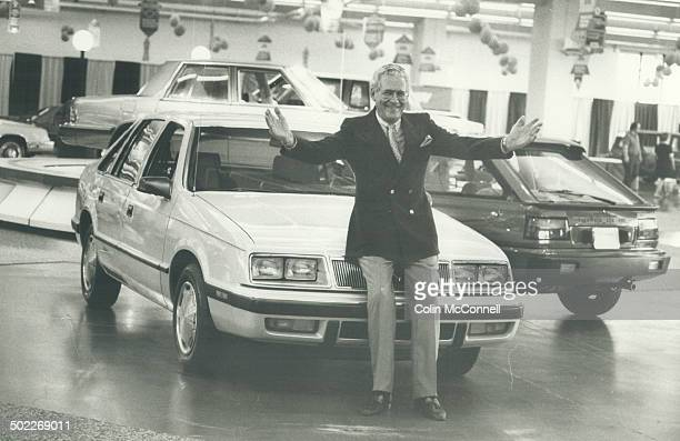 On a roll and loving it Chrysler Canada president MJ Closs is clearly proud of his company's sporty 1985 models Behind him is the LeBaron GTS a...