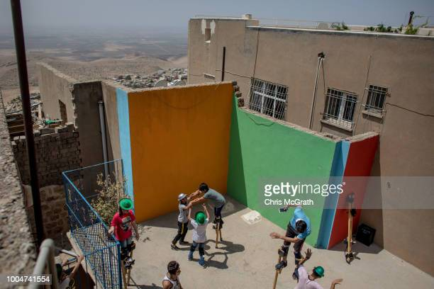 On a rooftop with a view to Syria children take part in a stilt workshop at the Mardin Sirkhane Center on July 23 2018 in Mardin Turkey The circus...