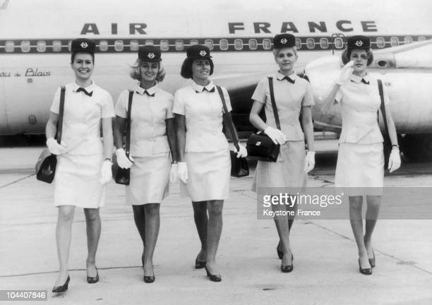 On a runaway in Paris airport five stewardesses are presenting the new uniform designed by the Spanish fashion designer Cristobal BALENCIAGA