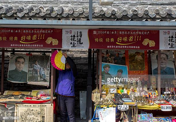 On a stall of the tourist commodity market outside Confucius Temple the portraits of Chinese political leaders are placed side by side with the...