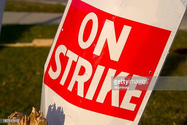 On a Strike sign in red and white poster