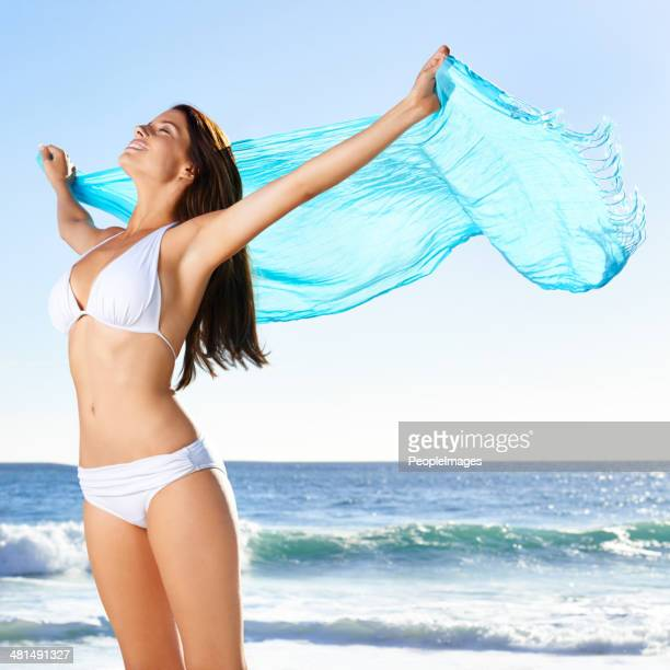 on a summer breeze... - sarong stock photos and pictures