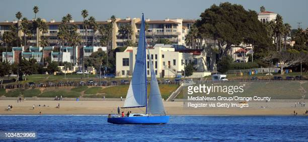 Scott Varley On a sunny postChristmas day a sailboat cruises the shoreline just off Redondo Beach and Veterans Park in the background