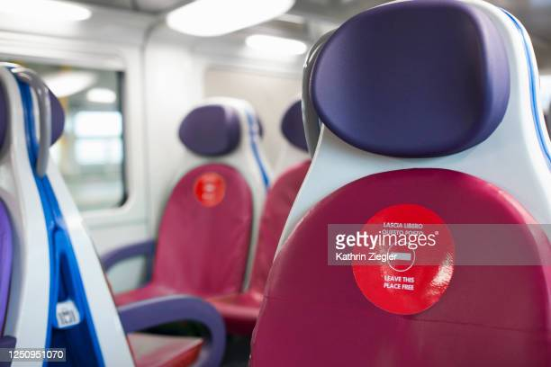 on a train during covid-19 pandemic: every other seat must be kept free - train interior stock pictures, royalty-free photos & images