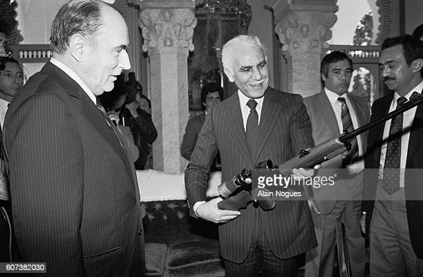 On a visit to Algeria French president Francois Mitterrand gives a reception during which he presents an elite FRF1 rifle to Algerian president...