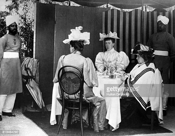 On a visit to Nice Queen Victoria of England takes tea with her daughter Princess Beatrice and Princess Victoria of SchleswigHolstein the wife of her...