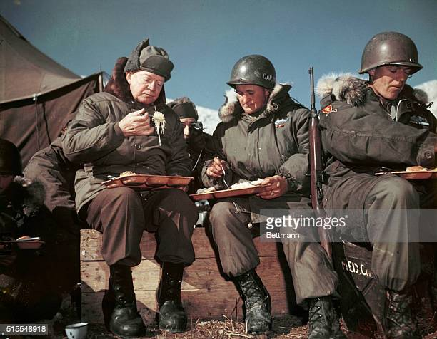 On a visit to the front lines President Eisenhower eats with American soldiers