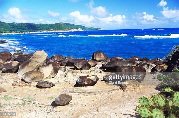 On a walk along the rugged coast January 3, 2000 at Dumfies in Carriacou, an island off Grenada, one comes across these huge dark stones that seem to...