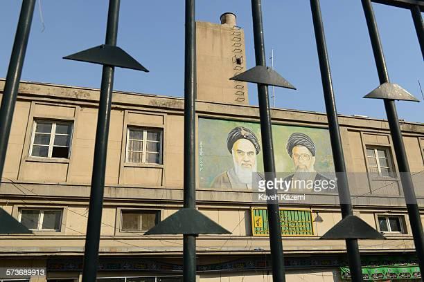 On a wall above the Basij Mobilisation Resistance Force building at Tehran university Ayatollah Ruhollah Khomeini and Ayatollah Ali Khamenei are seen...