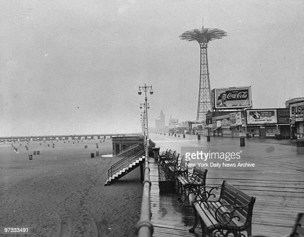 On a wet Labor Day the boardwalk at Coney Island is empty
