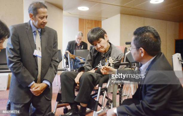 On a wheelchair Shinobu Sakamoto a Minamata mercurypoisoning disease patient meets with Indonesian government officials on Sept 27 in Geneva Sakamoto...