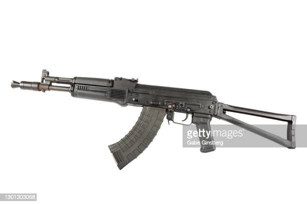ak-47 on a white background - weaponry stock pictures, royalty-free photos & images