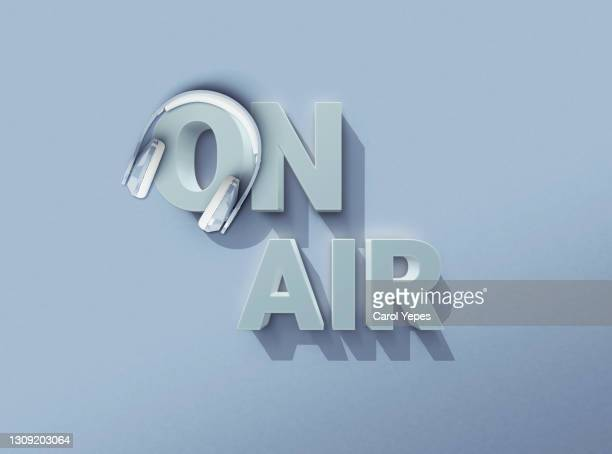 on air red  3d sign with headshet in pastel blue background - live broadcast stock pictures, royalty-free photos & images