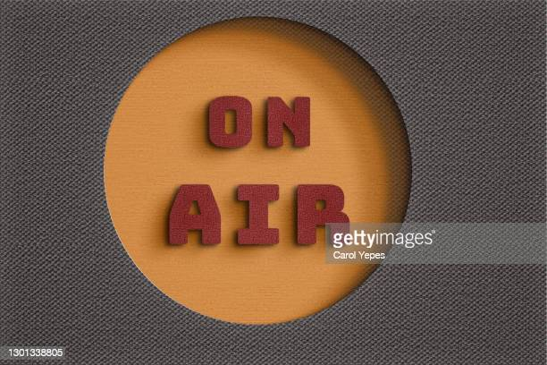 on air red  concrete single word in paper cut craft - abc broadcasting company stock pictures, royalty-free photos & images