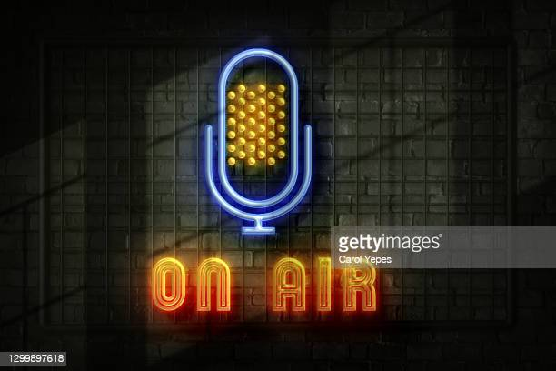 on air red neon light on black wall - abc broadcasting company stock pictures, royalty-free photos & images